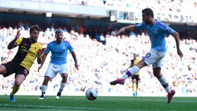 Man City hit eight in Watford demolition, Spurs rocked by Leicester