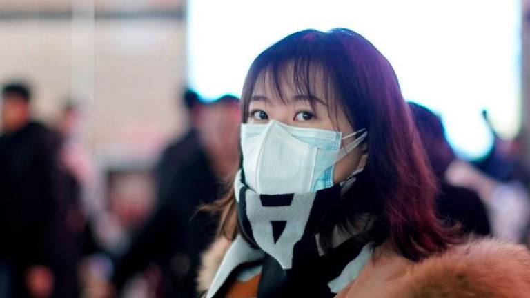 Individuals with respiratory symptoms advised to use medical face masks