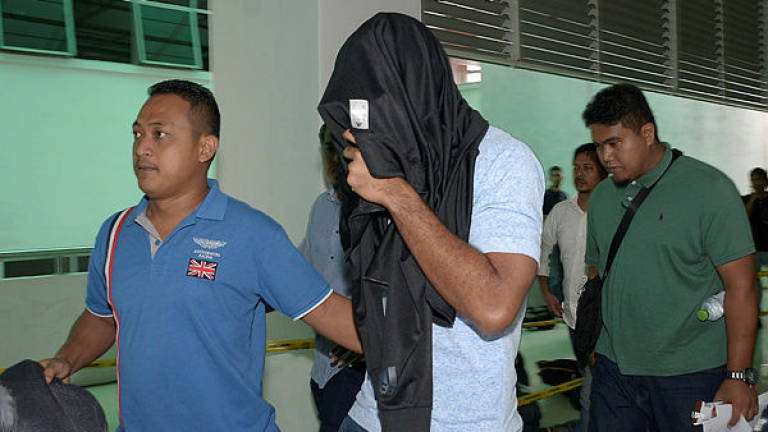 Cop, fireman claim trial to accepting bribes from massage parlour operator