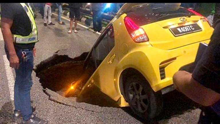 Owner of car 'swallowed' by caved-in road may have tough time making insurance claim