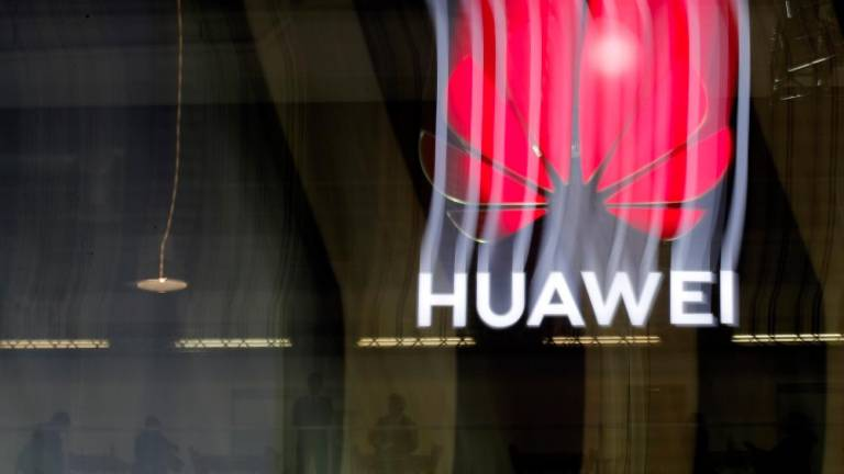 Huawei cancels new phone launch in Taiwan after China row