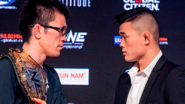 Shinya Aoki Stares down Christian Lee at ONE: Enter The Dragon PC