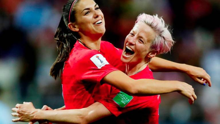 Five-star Morgan leads USA to record women's World Cup win