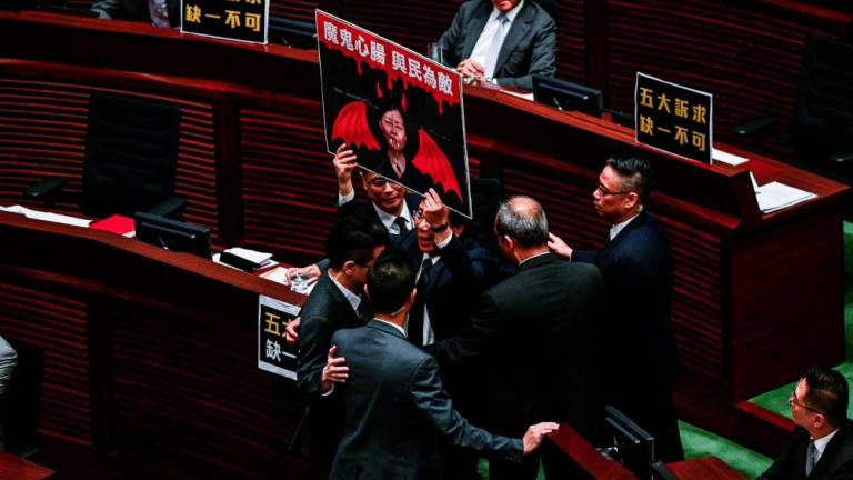 Hong Kong opposition lawmakers ejected for heckling leader