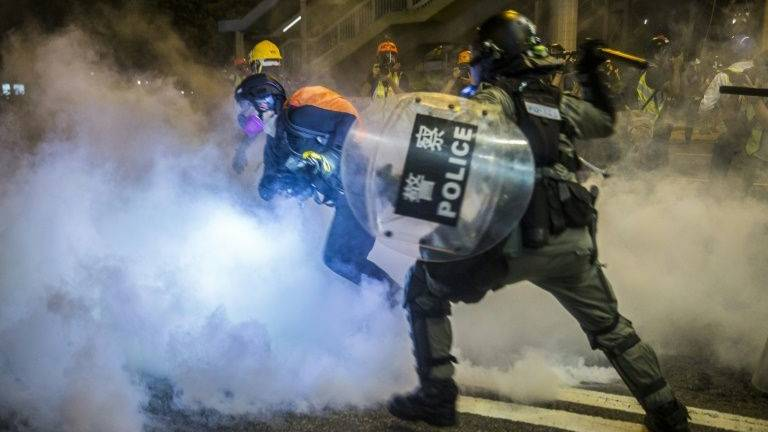 Bruised but unbowed Hong Kong police say no need for China intervention