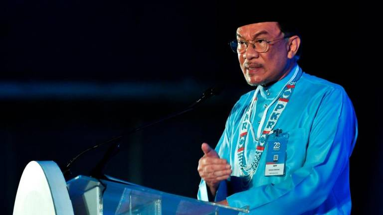 Anwar apologises for PKR Youth ruckus, asks for patience as police investigate