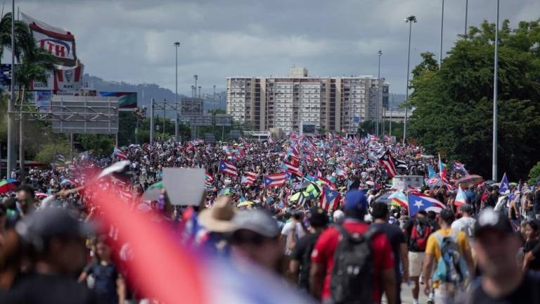 People take to the Las Americas Highway in San Juan, Puerto Rico, July 22, 2019 on day 9th of continuous protests demanding the resignation of Governor Ricardo Rosselló. — AFP
