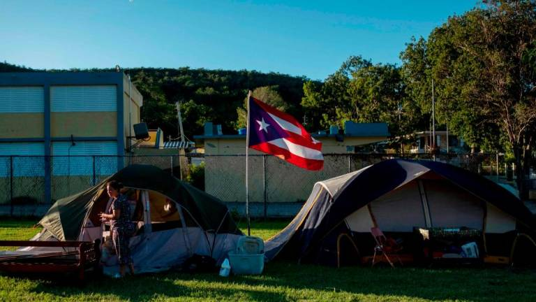 Living in tents, thousands of Puerto Rico's earthquake survivors wait for relief