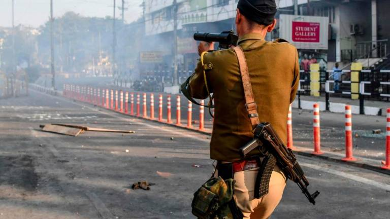 India protest hotspot offline as two shot dead