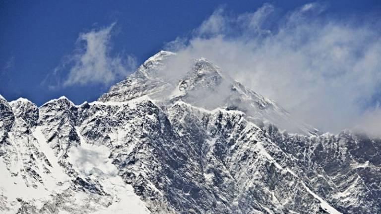 Traffic jam' on Everest as two more climbers die reaching summit