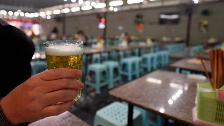 Beer sales fizzle in Vietnam as drink-driving law hits bars
