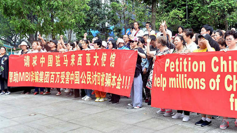 China nationals protest outside embassy