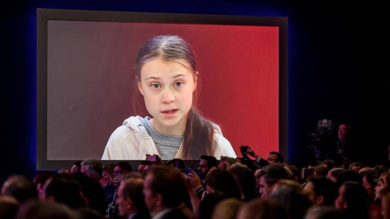 Thunberg slams climate change inaction as Davos awaits Trump