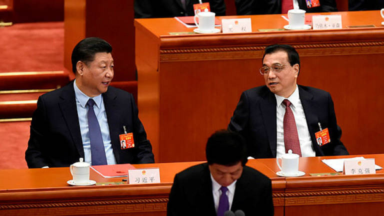 China does not ask firms to spy on others: premier