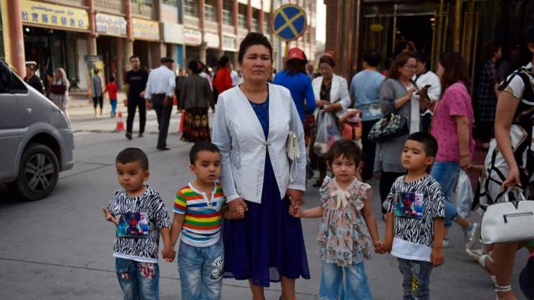China forcibly sterilises Uighurs to control population: report