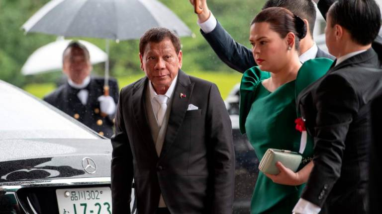 Philippines' Duterte cuts short Japan trip in 'unbearable pain'