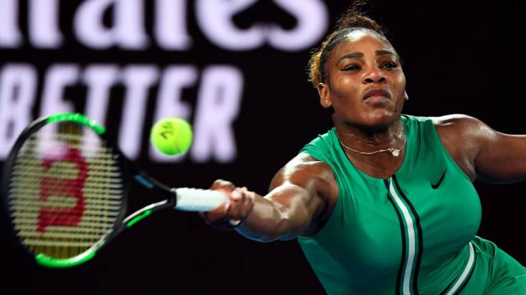 Serena Williams of the US hits a return against Romania's Simona Halep during their women's singles match on day eight of the Australian Open tennis tournament in Melbourne on Jan 21, 2019. — AFP