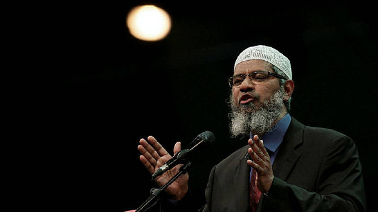Zakir Naik not listed as wanted by Interpol: Muhyiddin