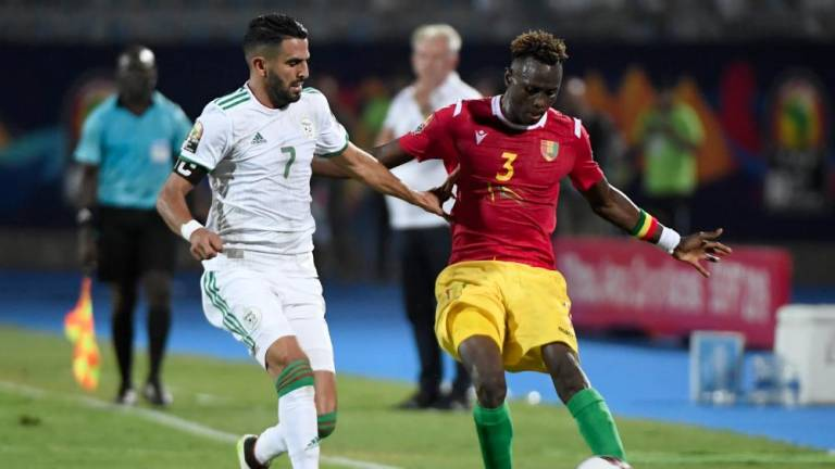 Mahrez helps Algeria brush Guinea aside to reach last eight