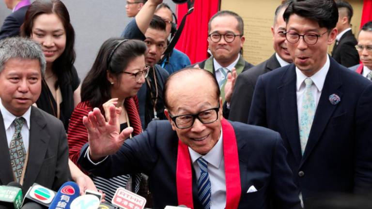 Hong Kong's Li Ka-shing weighs in on crisis with poetic adverts