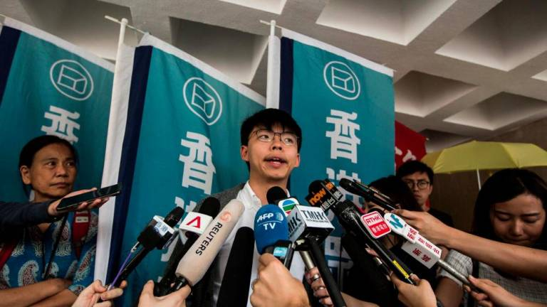 Hong Kong student leader Joshua Wong sent back to jail