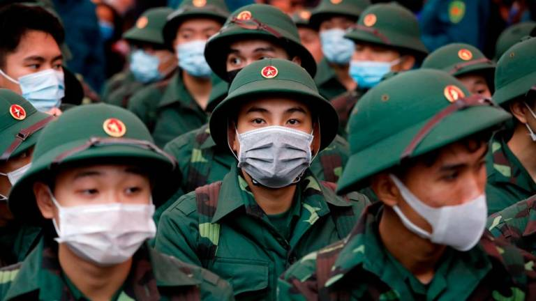 Vietnam quarantines area with 10,000 residents over coronavirus
