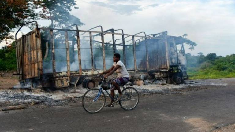 Anger still high among the ashes after I. Coast ethnic clashes