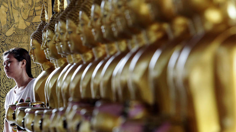 A woman visits a temple in preparation for Wesak Day.