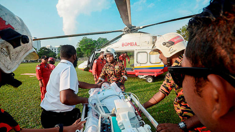 Fire department's mercy flight rescues two pregnant Orang Asli women