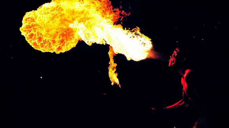 An entertainer showing his skills with fire.