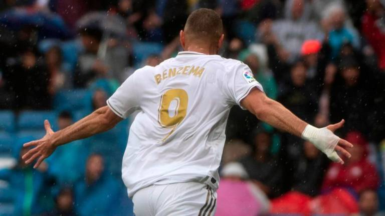 Benzema brilliance inspires Real, Fati lights up Barca