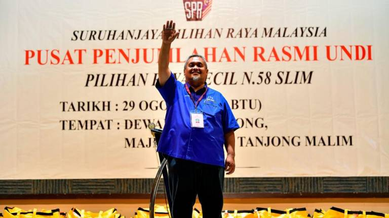 BN retains Slim with landslide win
