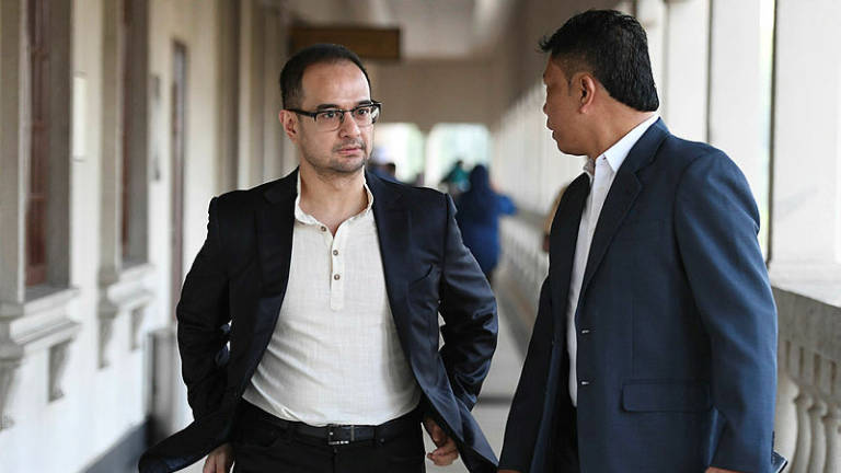Riza Aziz charged on five counts of money laundering involving US$248 million