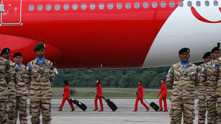 Air Asia X stewardess are seen preparing to board the aircraft which will carry the second batch of Malaysian Battalion 850-2 for the United Nations Interim Force in Lebanon (Unifil) at the Royal Malaysian Air Force Airbase in Subang.