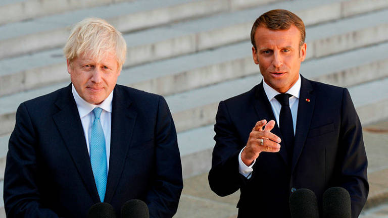 Macron backs more Brexit talks but insists no concessions