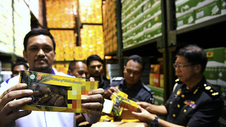 Packets of dates with unauthorised halal logo seized