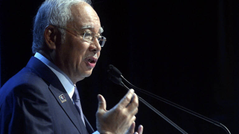 Najib makes new year vow of security, welfare