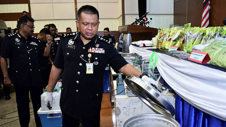 Cops bust drug syndicate, seize drugs worth RM10 million