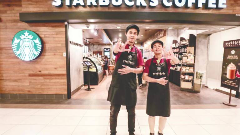 'Silent baristas' take the lead at Starbucks Signing Store