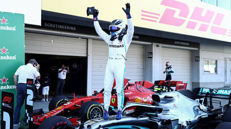 Bottas wins Japanese GP, Mercedes clinch record constructors' title
