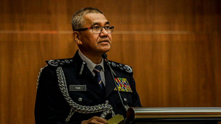 Only seven of 66 temple riot suspects have come forward, says IGP