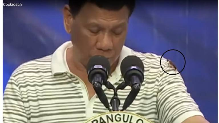(Video) Cockroach crawls up Philippines' Duterte during live speech