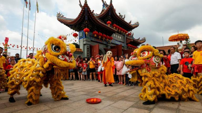 Lion dance troupe performs on the celebration of the Lunar New Year in Kuan Yin Temple Klang. Asyraf Rasid / the sun