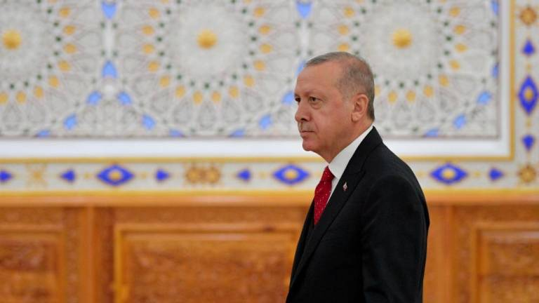 Erdogan says drilling off Cyprus to continue despite warning