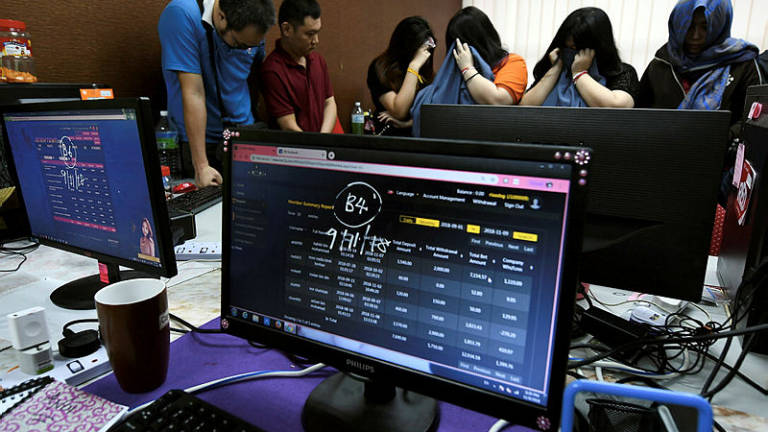 Seven foreigners among 16 arrested for alleged online gambling