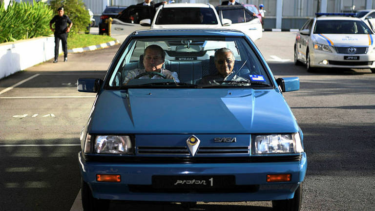 Johor Sultan drives Dr M to airport in 34-year-old proton saga