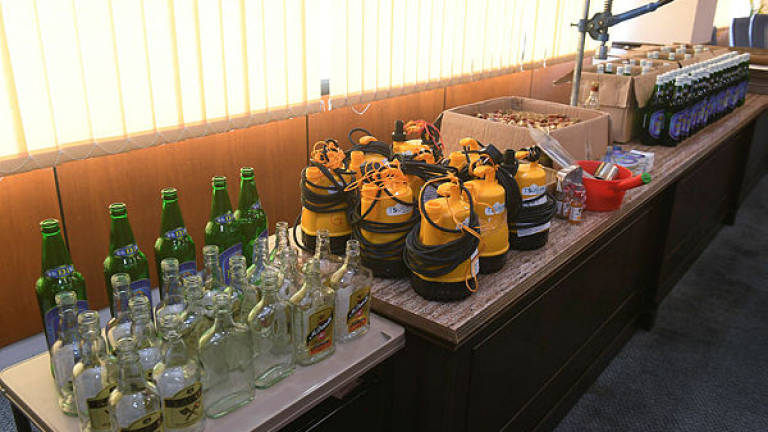 Two detained, nine boxes of alcoholic drinks seized in Port Dickson