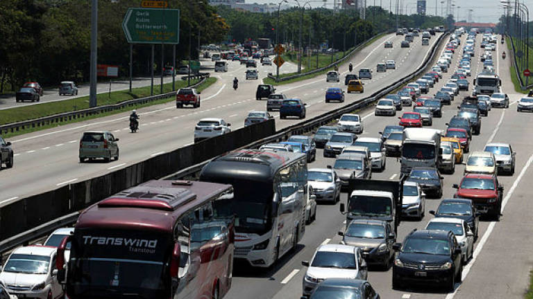 Heavy and orderly traffic as holiday-goers make their way home