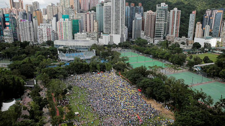 Tale of two cities: Hong Kong turmoil may boost Singapore