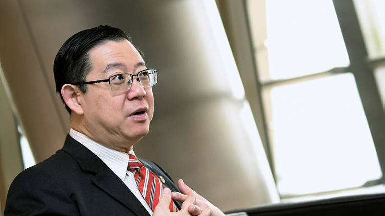 Be a registered voter in your constituency when seeking welfare aid: Lim
